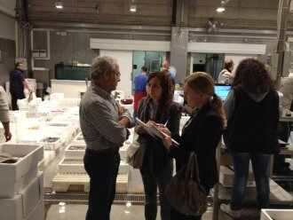 People from Innovation Norway together with a purchaser at Wholesale Fish Market in Milan.